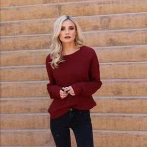 Deep red knit sweater with back cut out